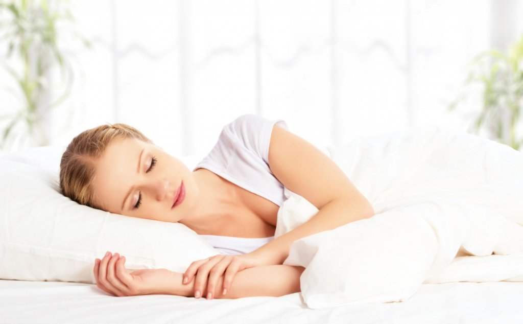 24141659 - young beautiful woman sleeping and smiles in his sleep in  bed